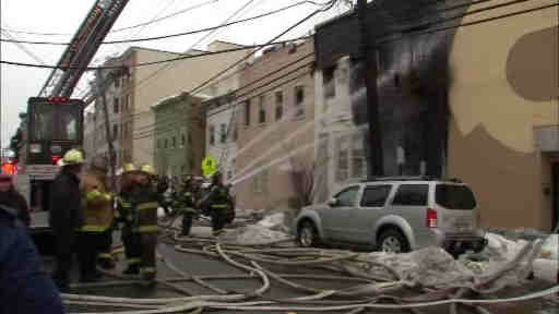 "<div class=""meta ""><span class=""caption-text "">Fire officials rushed to the scene to battle a 5 alarm blaze inside a residential building in Weehawken, New Jersey.</span></div>"