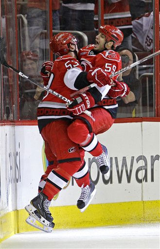 Carolina Hurricanes&#39; Jeff Skinner &#40;53&#41; and Chad LaRose &#40;59&#41; celebrate Skinner&#39;s goal against the Philadelphia Flyers during the first period of an NHL hockey game in Raleigh, N.C., Friday, Feb. 18, 2011. &#40;AP Photo&#47;Gerry Broome&#41; <span class=meta>(AP Photo&#47; Gerry Broome)</span>