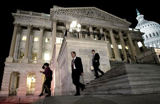 Congressmen walk down the steps of the House of Representatives as they work throughout the night on a spending bill, on Capitol Hill in Washington, Friday, Feb. 18, 2011 &#40;AP Photo&#47;J. Scott Applewhite&#41; <span class=meta>(AP Photo&#47; J. Scott Applewhite)</span>