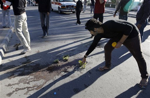 "<div class=""meta ""><span class=""caption-text "">Bahraini protester places a flower over a blood stain marking the place were a Bahraini anti-government protester was severely injured, during clashes with Bahraini military forces on Friday night near the Pearl roundabout in Manama, Bahrain, Saturday, Feb. 19, 2011. (AP Photo/Hassan Ammar) (AP Photo/ Hassan Ammar)</span></div>"
