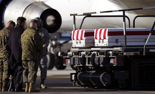Vice Chairman of the Joint Chief of Staff Gen. James E. Cartwright, right, pray over the transfer cases containing the remains of Marine Sgt. Matthew DeYoung, Airman 1st Class Christoffer P. Johnson and Airman 1st Class Corey C. Owens upon  arrival at Dover Air Force Base, Del. on Saturday  Feb. 19, 2011.  &#40;AP Photo&#47;Jose Luis Magana&#41; <span class=meta>(AP Photo&#47; Jose Luis Magana)</span>