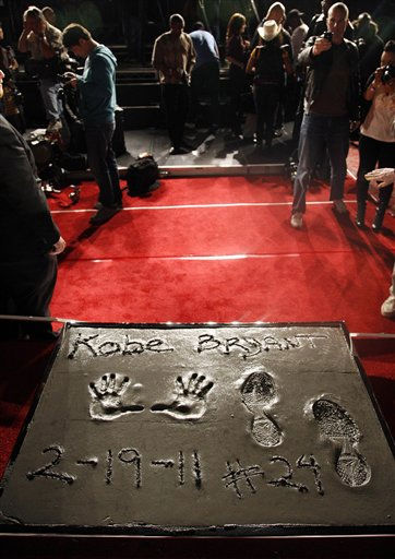 "<div class=""meta ""><span class=""caption-text "">Spectators and media gather after Los Angeles Lakers guard Kobe Bryant had his hands and feet etched in concrete at Grauman's Chinese Theatre in Los Angeles, Saturday, Feb. 19, 2011. Bryant is the first athlete to have the honor. (AP Photo/Jason Redmond) (AP Photo/ Jason Redmond)</span></div>"