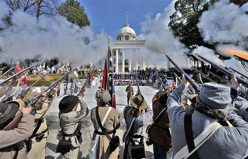 Members of Sons of Confederate Veterans fire their rifles in celebration in Montgomery, Ala. on Saturday, Feb. 19, 2011 following the re-enactment of the 1861 swearing-in ceremony of Confederate States of America provisional President Jefferson Davis on the steps of the Alabama State Capitol. &#40;AP Photo&#47;Kevin Glackmeyer&#41; <span class=meta>(AP Photo&#47; Kevin Glackmeyer)</span>