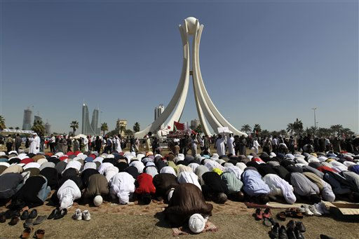Bahraini anti-government protesters pray at the Pearl roundabout in Manama, Bahrain, Sunday, Feb. 20, 2011. Bahrain&#39;s opposition leaders gathered Sunday to examine offers for talks by Bahrain&#39;s rulers after nearly a week of protests and deadly clashes that have sharply divided the strategic Gulf nation. &#40;AP Photo&#47;Hassan Ammar&#41; <span class=meta>(AP Photo&#47; Hassan Ammar)</span>