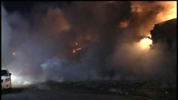 Firefighters battled a four-alarm fire Tuesday night at a recycling facility in the Greenpoint section of Brooklyn.