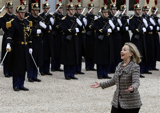 U.S Secretary of State Hillary Rodham Clinton arrives at the Elysee palace for a crisis summit on Libya, in Paris, Saturday, March, 19, 2011. Britain and France took the lead in plans to enforce a no-fly zone over Libya on Friday, sending British warplanes to the Mediterranean and announcing a crisis summit in Paris with the U.N. and Arab allies. &#40;AP photo&#47;Remy de la Mauviniere&#41; <span class=meta>(AP Photo&#47; Remy de la Mauviniere)</span>