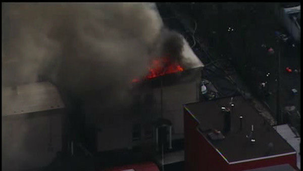 "<div class=""meta ""><span class=""caption-text "">Two buildings housing four apartments in Bayonne, New Jersey caught fire on Wednesday.  The fire went to four alarms. (WABC Photo)</span></div>"