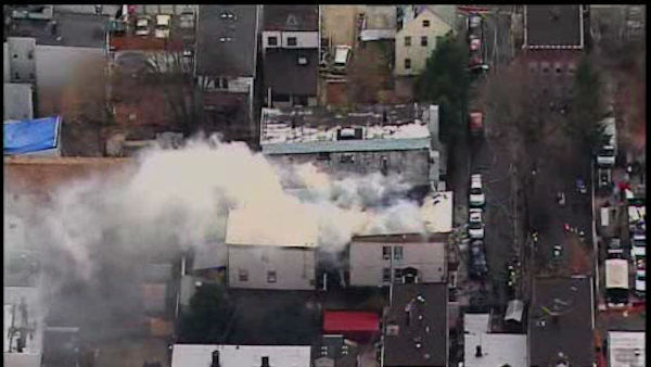 Two buildings housing four apartments in Bayonne, New Jersey caught fire on Wednesday.  The fire went to four alarms. <span class=meta>(WABC Photo)</span>