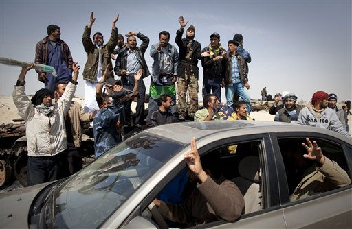 "<div class=""meta image-caption""><div class=""origin-logo origin-image ""><span></span></div><span class=""caption-text"">Libyan rebels jubilate after taking the city  of Ajdabiya, south of Benghazi, eastern Libya, Saturday, March 26, 2011. Libyan rebels regained control of the eastern gateway city of Ajdabiya on Saturday after international airstrikes on Moammar Gadhafi's forces, in the first major turnaround for an uprising that once appeared on the verge of defeat. Ajdabiya's sudden fall to Gadhafi's troops spurred the swift U.N. resolution authorizing international action in Libya, and its return to rebel hands on Saturday came after a week of airstrikes and missiles against the Libyan leader's military. (AP Photo/Anja Niedringhaus) (AP Photo/ Anja Niedringhaus)</span></div>"
