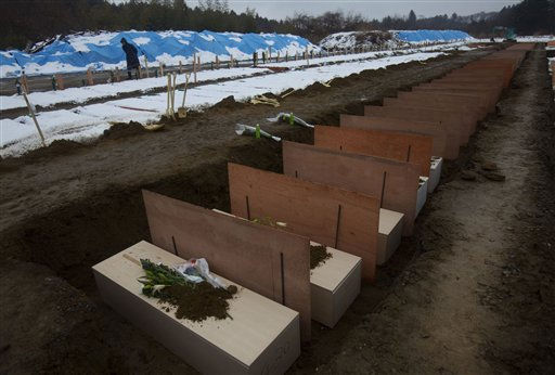Coffins are lined up at a mass grave site in Higashimatsushima, northeastern Japan Saturday, March 26, 2011, following the March 11 earthquake, tsunami and the subsequent crisis at the Fukushima Dai-ichi nuclear complex. &#40;AP Photo&#47;David Guttenfelder&#41; <span class=meta>(AP Photo&#47; David Guttenfelder)</span>