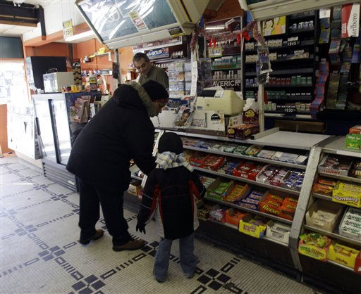 Rosmarie Walton and her grandson Rayshawn Chestnut shop at Coulson&#39;s News in Albany, N.Y., on Saturday, March 26, 2011. The winning ticket for the Mega Millions lottery jackpot worth &#36;319 million was sold at the variety store in Albany,  a lottery official said Saturday. &#40;AP Photo&#47;Mike Groll&#41; <span class=meta>(AP Photo&#47; Mike Groll)</span>