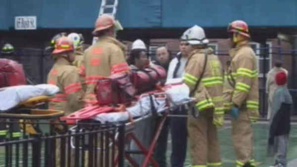 "<div class=""meta ""><span class=""caption-text "">At least five people were injured, one critically, in a fire Sunday morning at the Red Hook Houses in Brooklyn.</span></div>"