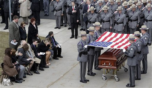 "<div class=""meta ""><span class=""caption-text "">New York State Troopers fold the flag during the funeral of New York State Trooper Kevin Dobson at the Eastern Hills Wesleyan Church in Amherst, N.Y., Friday, April 1, 2011. Dobson was was hit by a car and killed while writing a traffic ticket. (AP Photo/David Duprey) (AP Photo/ David Duprey)</span></div>"