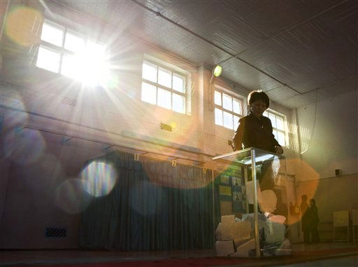 A woman votes during the Kazakh presidential election at a polling station at the Russian leased Baikonur cosmodrome, Kazakhstan, Sunday, April 3, 2011. Polls have opened in Kazakhstan for an election that is expected to overwhelmingly reconfirm the leadership of long-serving President Nursultan Nazarbayev. &#40;AP Photo&#47;Dmitry Lovetsky&#41; <span class=meta>(AP Photo&#47; Dmitry Lovetsky)</span>