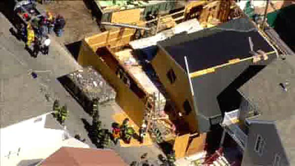 One worker is dead and three others injured when a house under construction collapses in Brooklyn.