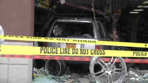 Two people was injured when a car plowed into an audio store in Patchogue, New York.