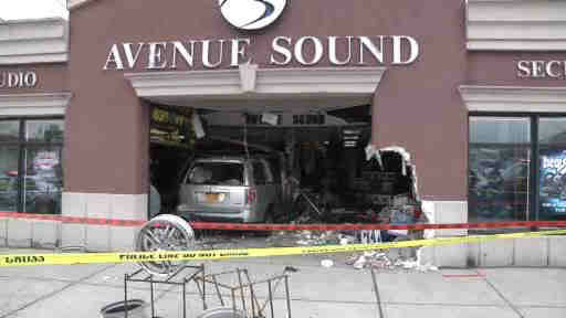 "<div class=""meta ""><span class=""caption-text "">Two people was injured when a car plowed into an audio store in Patchogue, New York.</span></div>"