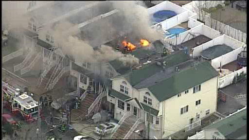 NewsCopter 7 over the scene of a 3-alarm fire that raced through three homes on Staten Island on Friday, April 11, 2014.