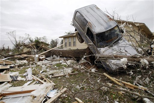 A vehicle rests on a tree after an overnight tornado in Tushka, Okla., Friday, April 15, 2011. &#40;AP Photo&#47;Sue Ogrocki&#41; <span class=meta>(AP Photo&#47; Sue Ogrocki)</span>