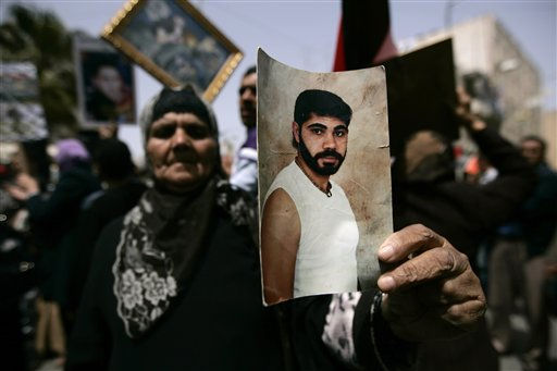 A Palestinian woman holds a photograph of a relative jailed in Israel, during a protest for the upcoming Prisoner&#39;s Day in the West Bank city of Ramallah, Saturday, April 16, 2011. &#40;AP Photo&#47;Majdi Mohammed&#41; <span class=meta>(AP Photo&#47; Majdi Mohammed)</span>