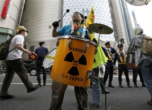 A protester beats a drum in front of a showroom of Tokyo Electric Power Co., &#40;TEPCO&#41; during an anti-nuclear plant demonstration in Tokyo, Saturday, April 16, 2011. More than 1,000 people took to the street for the rally. After the March 11 tsunami swamped Fukushima Dai-ichi knocked out emergency generators meant to power cooling systems. Since then, explosions, fires and other malfunctions have compounded efforts by TEPCO to repair the plant and stem radiation leaks.  &#40;AP Photo&#47;Shuji Kajiyama&#41; <span class=meta>(AP Photo&#47; Shuji Kajiyama)</span>