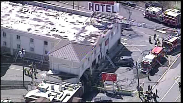 Firefighters battled a fire Wednesday afternoon at a Red Carpet Inn on Route 46 in Elmwood Park, New Jersey.