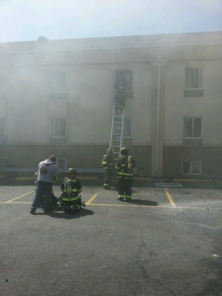 "<div class=""meta image-caption""><div class=""origin-logo origin-image ""><span></span></div><span class=""caption-text"">Firefighters battled a fire Wednesday afternoon at a Red Carpet Inn on Route 46 in Elmwood Park, New Jersey.  (Photo courtesy Rob Munoz)</span></div>"