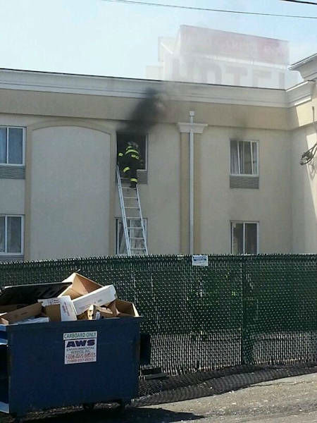 "<div class=""meta ""><span class=""caption-text "">Firefighters battled a fire Wednesday afternoon at a Red Carpet Inn on Route 46 in Elmwood Park, New Jersey.  (Photo courtesy Rob Munoz)</span></div>"
