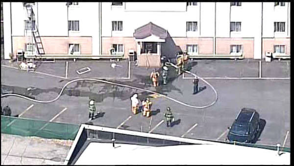 "<div class=""meta image-caption""><div class=""origin-logo origin-image ""><span></span></div><span class=""caption-text"">Firefighters battled a fire Wednesday afternoon at a Red Carpet Inn on Route 46 in Elmwood Park, New Jersey.</span></div>"