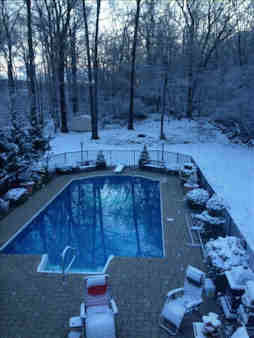The pool is open but the snow is surrounding in.  Photo sent in by Lisa in Hopewell Junction.