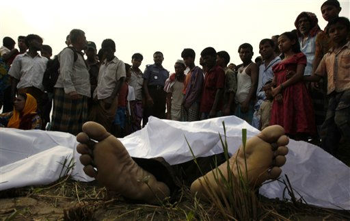 "<div class=""meta ""><span class=""caption-text "">Bangladeshi villagers look at the bodies of victims in a ferry accident in the River Meghna in Brahmanbaria district about 80 kilometers (50 miles) east of Dhaka, Bangladesh, Thursday, April 21, 2011. A ferry carrying about 100 passengers capsized in a river in eastern Bangladesh on Thursday, leaving at least 24 people dead and scores feared missing, a police official said. (AP Photo/Pavel Rahman) (AP Photo/ Pavel Rahman)</span></div>"