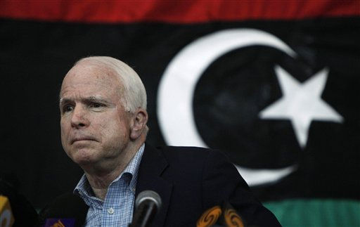 U.S. Sen. John McCain, backdropped with a pre-Gadhafi flag, talks during a press conference in Benghazi, Libya Friday, April 22, 2011. McCain, one of the strongest proponents in Congress of the American military intervention in Libya, said Friday that Libyan rebels fighting Moammar Gadhafi&#39;s troops are his heroes. &#40;AP Photo&#47;Nasser Nasser&#41; <span class=meta>(AP Photo&#47; Nasser Nasser)</span>
