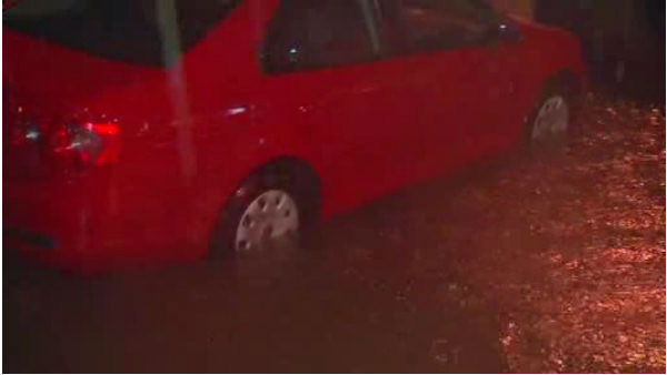 "<div class=""meta image-caption""><div class=""origin-logo origin-image ""><span></span></div><span class=""caption-text"">At least five inches of rain fell in parts of the Tri-State area Wednesday, leaving drivers to try and navigate their way through flooded roadways.</span></div>"