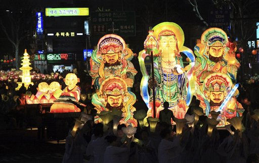 South Korean Buddhists carry huge lanterns during a lantern festival to celebrate the upcoming birthday of Buddha on May 10, on a street in Seoul, Saturday, May 7, 2011. &#40;AP Photo&#47;Ahn Young-joon&#41; <span class=meta>(AP Photo&#47; Ahn Young-joon)</span>