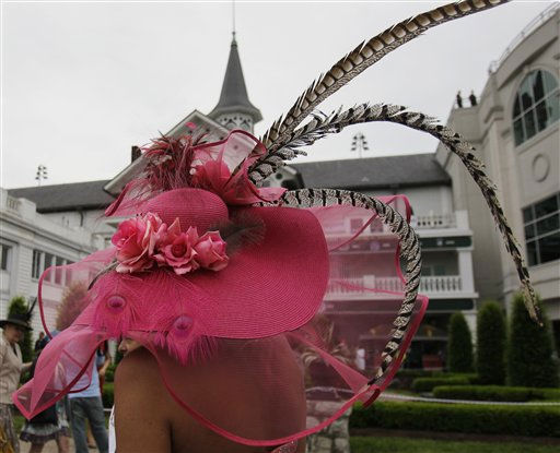 Karen Van Zant, from Broomfield, Colo., walks past the spires at Churchill Downs before the 137th Kentucky Derby horse race Saturday, May 7, 2011, in Louisville, Ky. &#40;AP Photo&#47;Ed Reinke&#41; <span class=meta>(AP Photo&#47; Ed Reinke)</span>