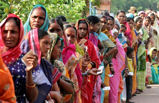 Indian women stand in a queue to cast their votes outside a polling booth at Keshpur in West Midnapore district of West Bengal state, India, Saturday, May 7, 2011. The fifth phase of the six-phase elections for the state of West Bengal is being held Saturday. &#40;AP Photo&#41; <span class=meta>(AP Photo&#47; Anonymous)</span>