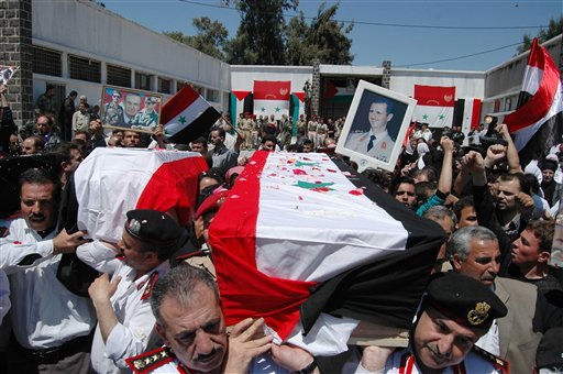 "<div class=""meta ""><span class=""caption-text "">In this photo released by the Syrian official news agency SANA, Syrian military police carry coffins as they prepare to send the bodies of eleven killed soldiers and security force members to their families for burial, out of a military hospital in the central city of Homs, Syria, Saturday, May 7, 2011. The agency did not report the circumstances of their deaths but they are believed to have been victims of the ongoing civil unrest against the government. (AP Photo/SANA)  EDITORIAL USE ONLY (AP Photo/ HO)</span></div>"