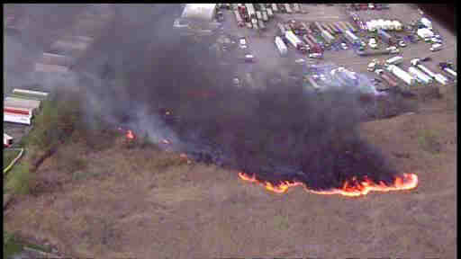 A large brush fire destroyed some cars in Woodbridge Township, New Jersey on Wednesday afternoon.