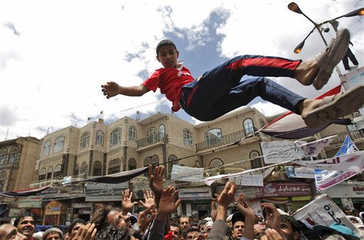 "<div class=""meta ""><span class=""caption-text "">Anti-government protestors reach up to catch a youth after throwing him into the air during a demonstration demanding the resignation of Yemeni President Ali Abdullah Saleh, in Sanaa, Yemen, Saturday, May 21, 2011. (AP Photo/Hani Mohammed) (AP Photo/ Hani Mohammed)</span></div>"
