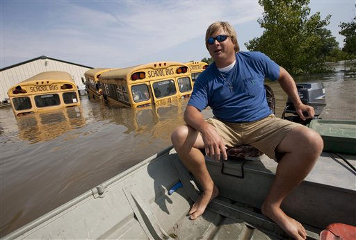 Chris Lynn checks his fathers property which is still surrounded by floodwaters from the Mississippi River in Vicksburg, Miss., Saturday, May 21,  2011. Lynn said that the Mississippi River floodwater had receded several inches from Friday.  &#40;AP Photo&#47;Dave Martin&#41; <span class=meta>(AP Photo&#47; Dave Martin)</span>
