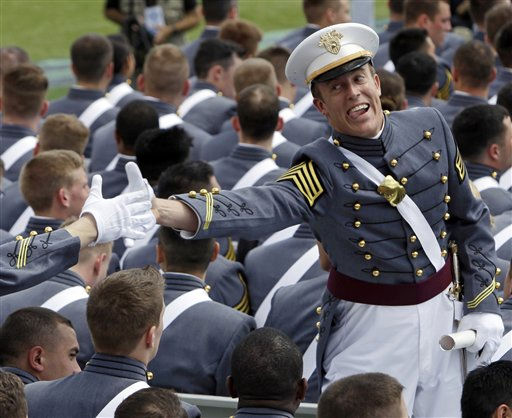 "<div class=""meta ""><span class=""caption-text "">A cadet reacts after receiving his diploma during a graduation and commissioning ceremony at the U.S. Military Academy in West Point, N.Y., on Saturday, May 21, 2011.   (AP Photo/Mike Groll) (AP Photo/ Mike Groll)</span></div>"