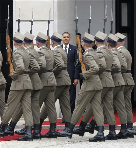 "<div class=""meta ""><span class=""caption-text "">Soldiers march past U.S. President Barack Obama as he takes part in an arrival ceremony at the presidential palace in Warsaw, Poland, Saturday, May 28, 2011. President Barack Obama is meeting with Poland's president as he begins the last day of his European tour.  Polish President Bronislaw Komorowski greeted Obama at the presidential palace in a formal ceremony. The two leaders are meeting to discuss democracy and security issues. (AP Photo/Charles Dharapak) (AP Photo/ Charles Dharapak)</span></div>"
