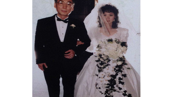 Lucy Yang on her wedding day with her father.