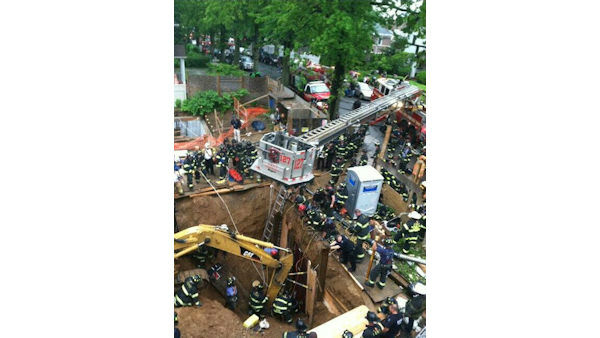 "<div class=""meta ""><span class=""caption-text "">The FDNY worked to rescue a construction worker trapped in waist-deep mud in a 15-foot trench in Kew Gardens, Queens on Tuesday. (Photo/FDNY)</span></div>"