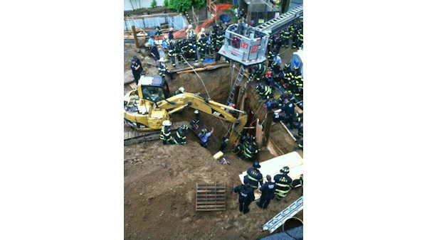 The FDNY worked to rescue a construction worker trapped in waist-deep mud in a 15-foot trench in Kew Gardens, Queens on Tuesday. <span class=meta>(Photo&#47;FDNY)</span>