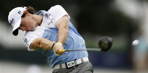 Rory McIlroy, of Northern Ireland, drives from the ninth tee during the third round of the U.S. Open Championship golf tournament in Bethesda, Md., Saturday, June 18, 2011. &#40;AP Photo&#47;Matt Slocum&#41; <span class=meta>(AP Photo&#47; Matt Slocum)</span>
