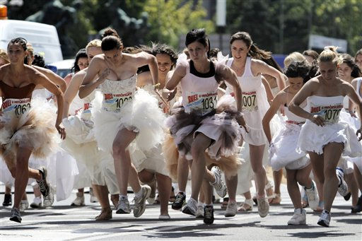 Brides compete in a race in central Belgrade, Serbia, Sunday, June 19, 2011. About fifty brides participated in an annual bridal race in the Serbian capital on Sunday, competing for numerous prizes, including the bridal gowns they had chosen to race in. &#40;AP Photo&#47;Marko Drobnjakovic&#41; <span class=meta>(AP Photo&#47; Marko Drobnjakovic)</span>