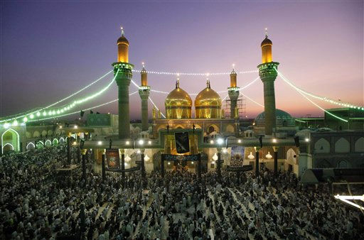 Shiite pilgrims gather at the Imam Moussa al-Kadhim shrine for the annual commemoration of the Saint&#39;s death, in the Shiite district of Kazimiyah, in Baghdad, Iraq, Monday, June 27, 2011. &#40;AP Photo&#47;Hadi Mizban&#41; <span class=meta>(AP Photo&#47; Hadi Mizban)</span>