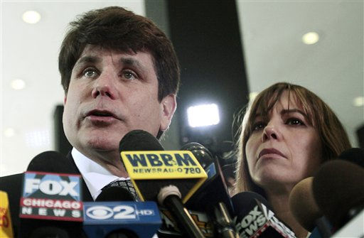Former Illinois Gov. Rod Blagojevich speaks to the media at the Federal Courthouse Monday, June 27, 2011 in Chicago. Blagojevich has been convicted of 17 of the 20 charges against him, including all 11 charges related to his attempt to sell or trade President Barack Obama&#39;s vacated Senate seat. At right is his wife Patti.  &#40;AP Photo&#47;Kiichiro Sato&#41; <span class=meta>(Photo&#47;Kiichiro Sato)</span>