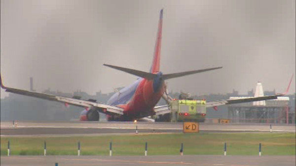 "<div class=""meta image-caption""><div class=""origin-logo origin-image ""><span></span></div><span class=""caption-text"">A rough landing at LaGuardia Airport where a landing gear on a Southwest plane when landing. There were a total of 150 people on board.</span></div>"